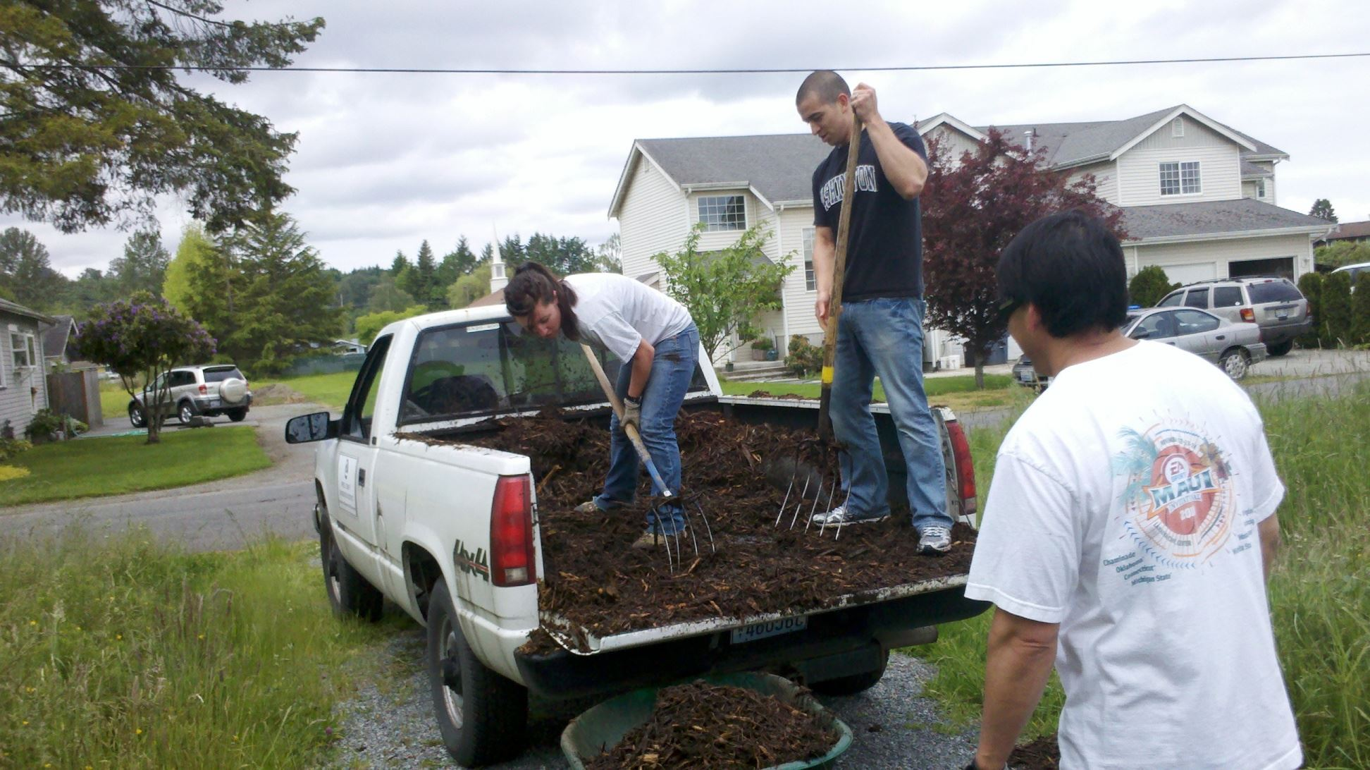 Using Pitchforks to Take Mulch Out of a Truck Bed