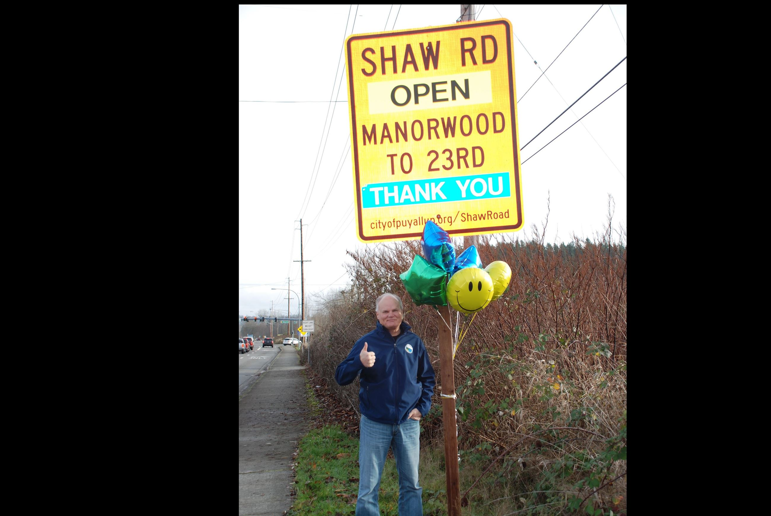 Shaw Road open mayor with sign