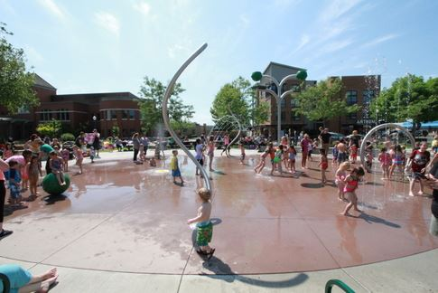 Kids Playing in Spray Park