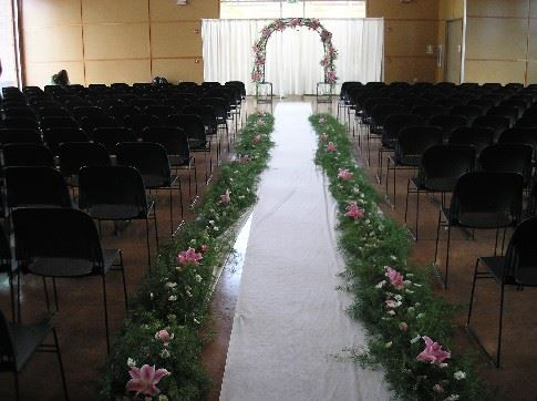 Orchids line an aisle before a wedding