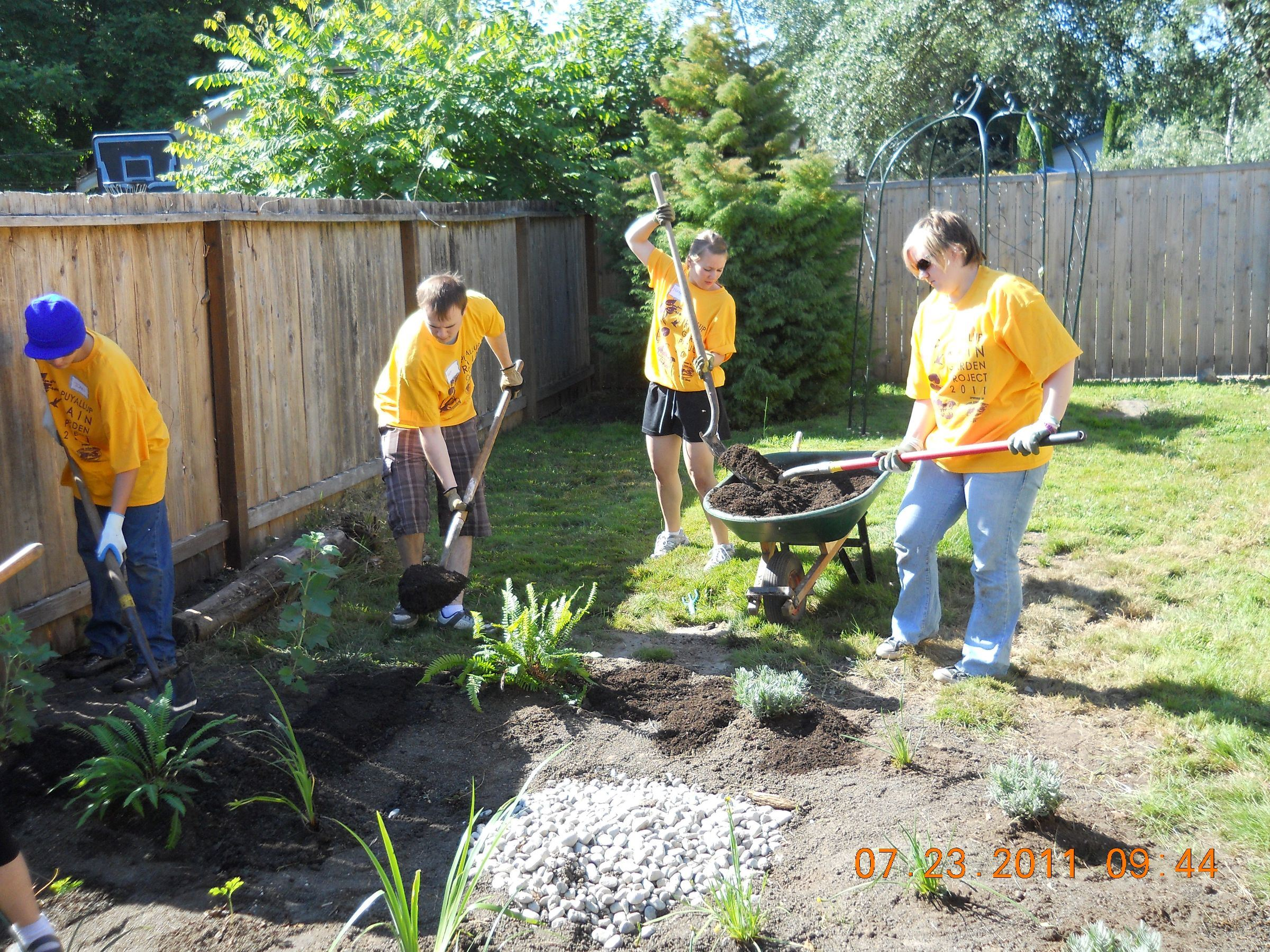 Volunteers Work on a Rain Garden